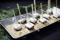 For a catered party in Cohasset, Kate's Table prepared marshmallows dipped in chocolate on a bed of graham cracker crumbs.